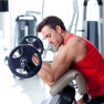 man with weight training equipment on sport gym club